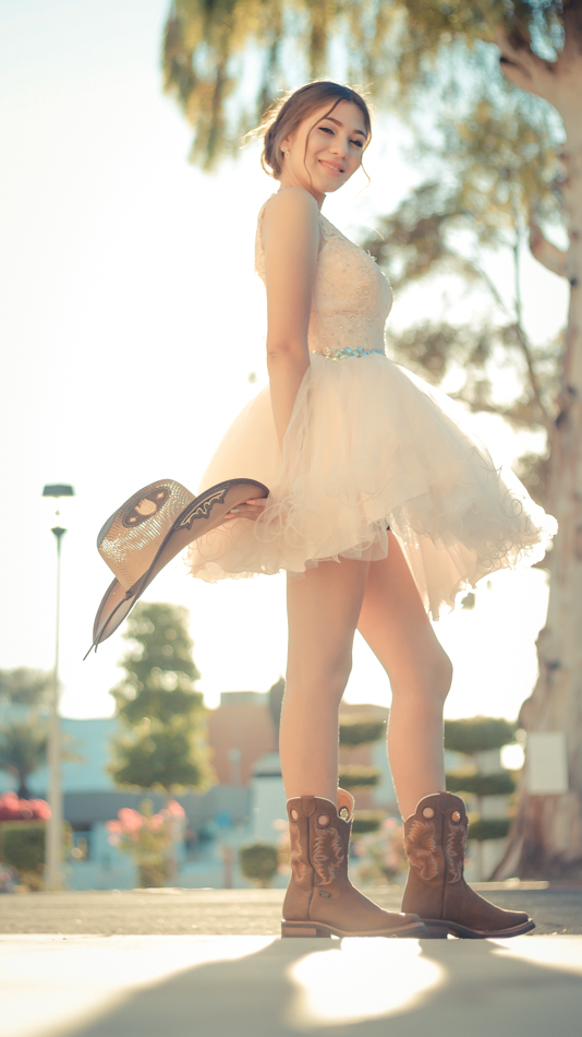 XV vaquera con botas y sombrero